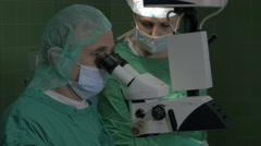 Cataract eye surgery, surgeon, microscope, tilt down, close up, ophthalmology. Stock Footage