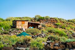 Self-made hovel in a tropics. Photo taken in Tenerife coast. Canary Islands. - stock photo