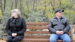 Sad couple on a bench Stock Footage