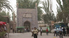 Muslim men leaving Id Kah Mosque, China Stock Footage