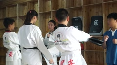 Chinese teenager in practicing taekwondo Stock Footage