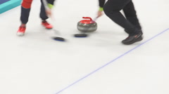 Rub the ice with special brushes curling Stock Footage