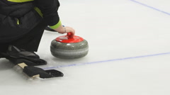 Curling. Throw a stone on ice. - stock footage