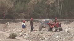 Construction workers moving rocks, China Stock Footage
