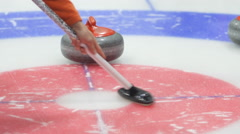 Rub the ice with special brushes curling - stock footage