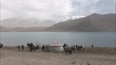Tourists outside Kyrgyz hut, Xinjiang, China Stock Footage