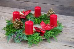 Advent wreath with candles on the wooden table, decorations - stock photo