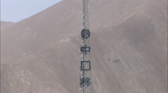 Cell phone tower with mountains, China Stock Footage