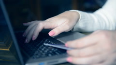 Woman buying with credit card, using laptop computer. Stock Footage