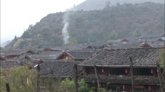 Stock Video Footage of Naxi village with smoking chimneys, China