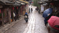 Cobbled street, shops, near Lijiang, China Stock Footage