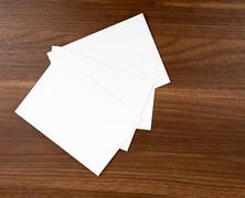 Four empty cards on wood table Stock Photos