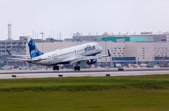 A Jetblue Airlines Embraer 190 aircraft landing - stock photo