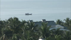 Sea boat, palm trees, hotel, Hainan, China Stock Footage