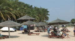 Sun loungers in Hainan beach resort, China Stock Footage
