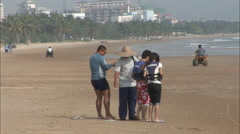 People walking on beach, Hainan, China Stock Footage