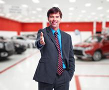 Car dealer handshake. - stock photo