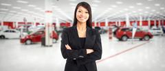 Car dealer chinese woman. - stock photo