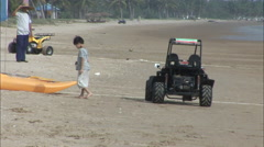 Chinese boy on beach, Hainan, China Stock Footage