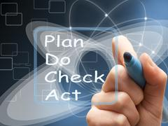 Stock Illustration of Hand writes Plan Do Check Act on screen