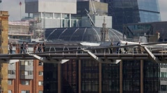 Tilt from the Millennium Bridge to a passing river boat Stock Footage