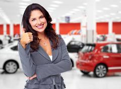 Car dealer woman with thumb. - stock photo