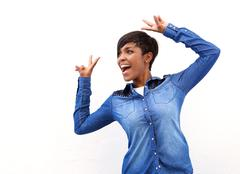 Smiling african american woman with peace sign hand gesture Stock Photos