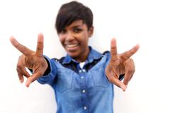 Smiling black woman with peace hand sign - stock photo