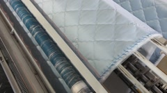 Mattress sewing on a sewing machine - stock footage