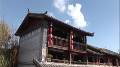 Naxi houses, tiled roof, balcony, China Stock Footage