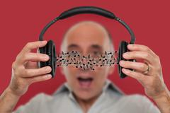 Man listening and visualizing music from headphones. Stock Photos