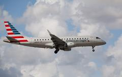 Embraer 175 of American Eagle Airlines landing at Miami International Airport. Stock Photos