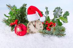 Christmas clock with Holly leaves and berries. Greeting card. - stock photo