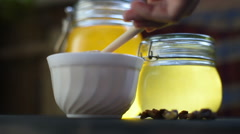 Pouring honey at bowl - stock footage