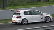 Stock Video Footage of 4k Volkswagen Golf Cup car race leaving pit lane