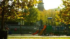 Orthodox church, park, swings, children, sunny autumn, sound Stock Footage