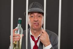 Business man drunk in jail - stock photo