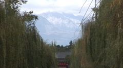 Mountains & willow trees, Chinese pavilion Stock Footage