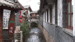 Old buildings & canal, Lijiang, China Stock Footage