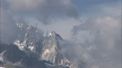 Clouds over snowy Yunnan Mountains, China Stock Footage