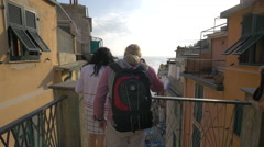 Tourists admiring the view from a balcony in Riomaggiore, Cinque Terre Stock Footage