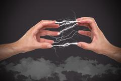 Hands with lightning in the fingers - stock photo