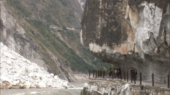People walking by Yangtze River, China Stock Footage