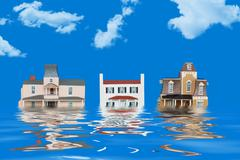 Model houses representing a flood - stock photo