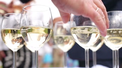People take glasses of sparkling white wine Stock Footage