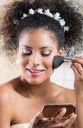 Closeup portrait of beautiful hispanic bride applying makeup on Stock Photos