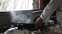 Chinese wok cooking, Yunnan, China - stock footage