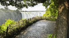 Panning shot of the mist from Victoria Falls in southern Africa Stock Footage