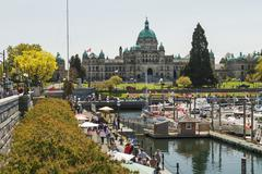 Busy afternoon view of Inner Harbour in Victoria, British Columbia, CANADA - stock photo