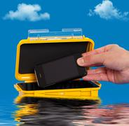 Storing a cell phone in a water resistant case - stock photo